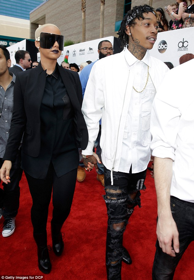 Walk this way: Taking the led, Wiz made sure to not let go of Amber's hand as everyone bustled around them