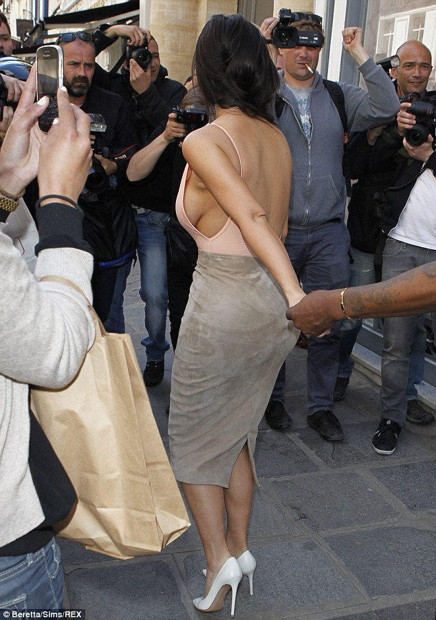Not exactly a blushing bride! The starlet was at definite risk of suffering a wardrobe malfunction, with her skimpy top cut away at the sides and the back