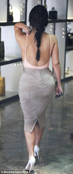 Just peachy! Kim's ensemble was just as impressive from the back, with the scoop design of her vest drawing the eye downwards towards her world-famous derriere