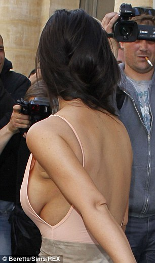 Dare to bare: Kim's backless, sideless vest was one of her most daring sartorial offerings to date