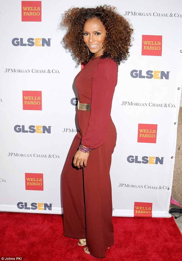 An Inspiration to all: Trans woman Janet Mock looked fabulous in her stylish red jumpsuit with semi-sheer sleeves as she was presented with the Inspiration Award for her tireless transgender rights activism