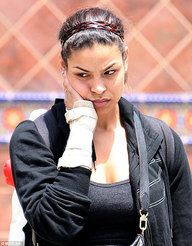 Down in the dumps: Jordin Sparks looked positively glum as she jetted back into Los Angeles on Monday after spending the previous few days in Las Vegas, where she attended Sunday night's Billboard Music Awards