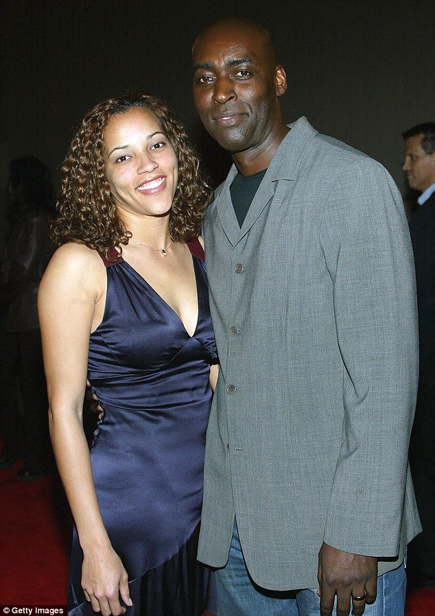 Actor Michael Jace's wife April (pictured left with her husband in 2004) was found dead from gunshot wounds at 8.30pm in Los Angeles on Monday. He has been booked for her murder