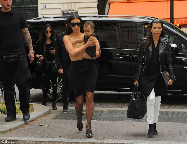 Family time: Kim's sister Kourtney was also with the reality star - and she looked lovely in white jeans and a black leather jacket