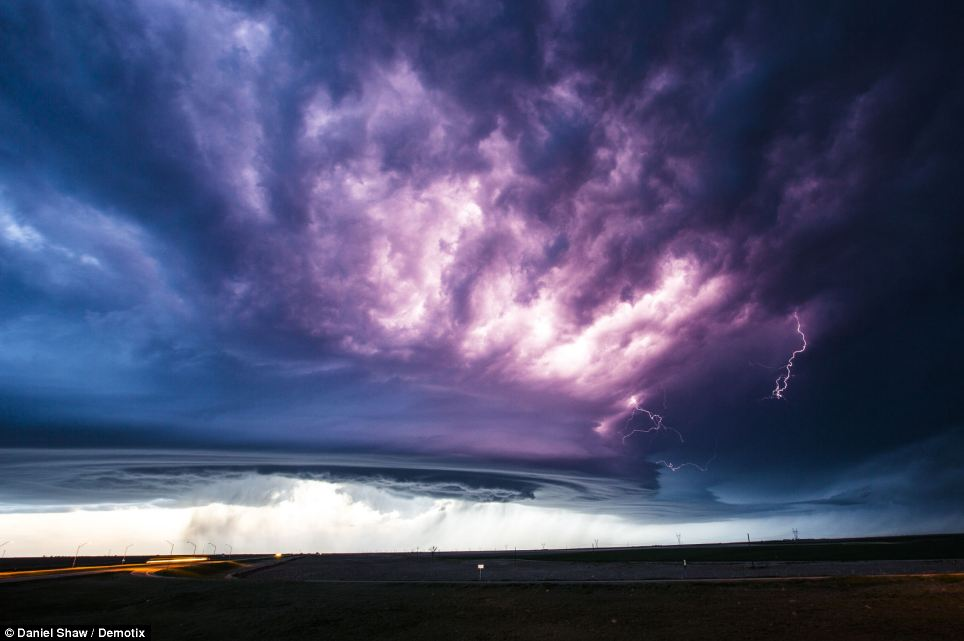Magical: With its purple skies and flashes of lightning, the supercell put on a magical display for the daring stormchasers