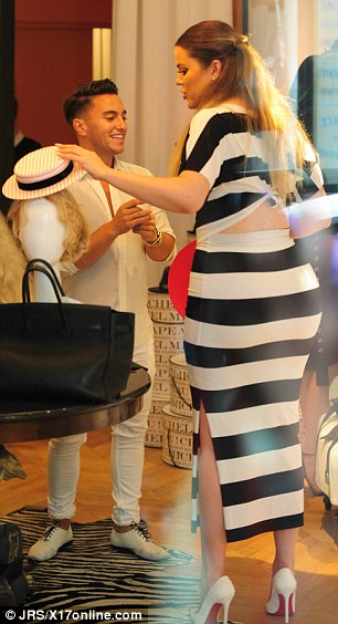 Not for the wedding: Clearly Khloe wasn't looking for a hat to wear for her sister's big day