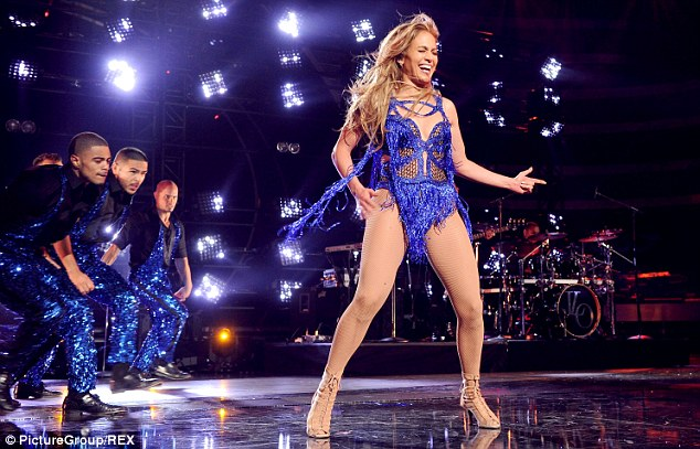 Singing star: J-Lo showed the American Idol wannabes how it's done as she sang on stage