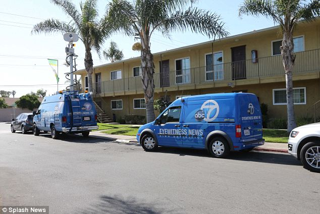 Scene: News vans line the Orange County complex where Garcia allegedly drugged his then 15-year-old victim before kidnapping her