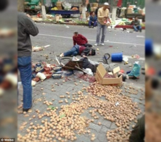Photos posted on social media site, Weibo, show bodies and debris from the market strewn about the streets