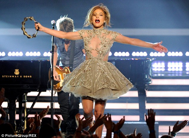 Hogging the spotlight: The stunning star swapped her outfit for a marginally more modest one as she took the stage for a performance with Keith Urban, Harry Connick Jr and Randy Jackson