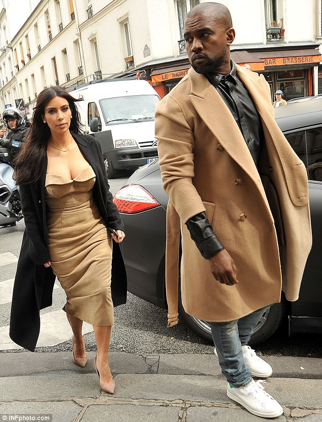 Wedding bells: Beyonce and Jay Z are said to be heading to Florence as the rapper will be best man when Kanye West marries Kim Kardashian on Saturday. Kim and Kanye are pictured in Paris on Wednesday