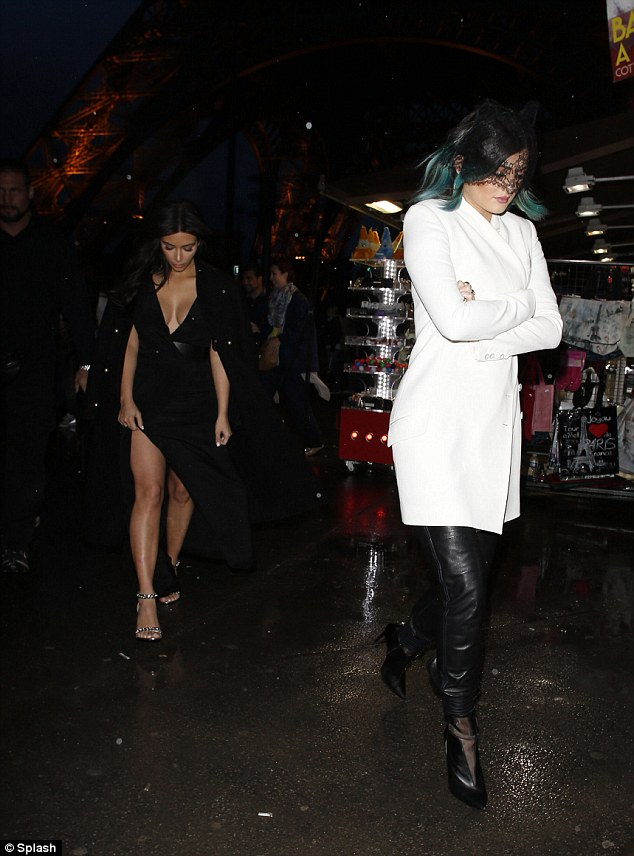 Whose idea was this? Kylie and Kim look rather down in the dumps despite the backdrop of the Eiffel Tower