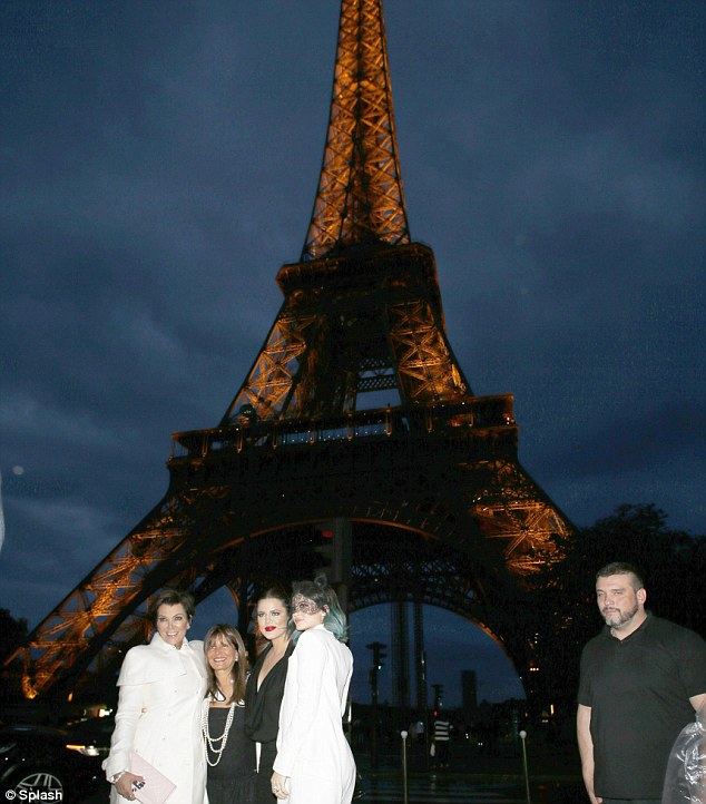We'll always have Paris! The group found their smiles as they posed for a pic in front of the Eiffel Tower