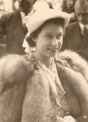 Ageless icon: The then Princess Elizabeth in 1951, left, and looking radiant in blue in 2014