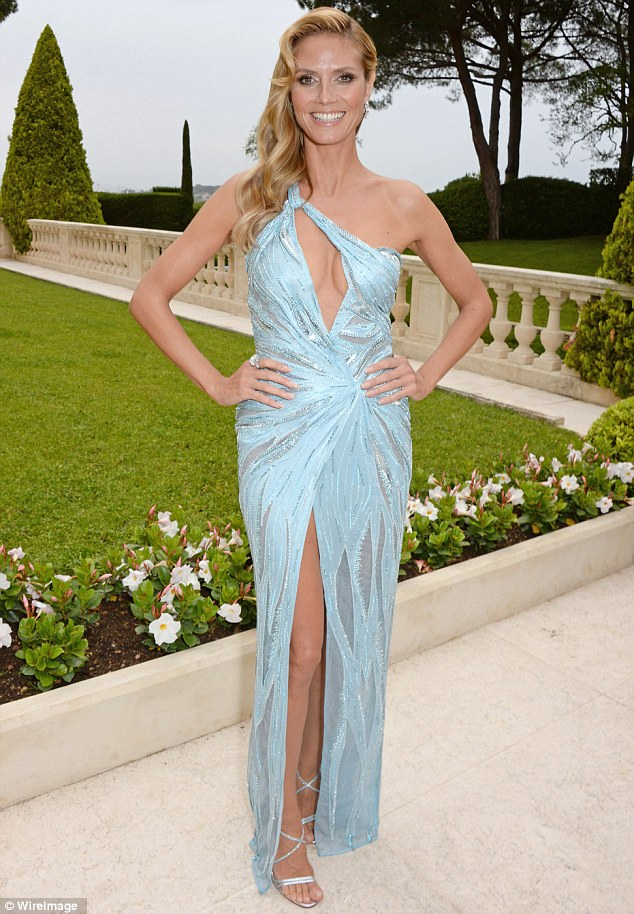 Fire and ice: Heidi Klum chose a cool silver-blue gown to wear to amfAR's AIDS gala during Cannes Film Festival on Thursday but raised temperatures by showing a lot of skin