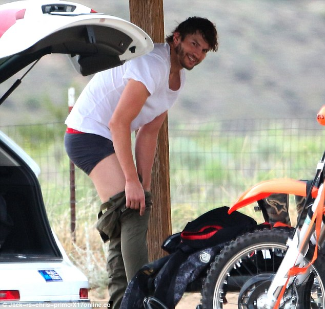 Stripping off: Ashton Kutcher stripped off before motocross riding in Los Angeles on Thursday