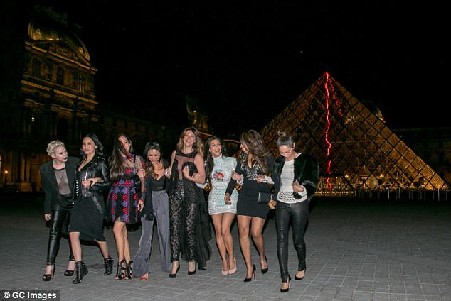 Touring the sights: After dinner they jumped in a party van and hit landmarks like the Louvre
