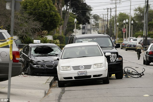 Crime scene: Elliot Rodger's black BMW can be seen along with a mangled bike in Isla Vista where seven people are dead following a shooting spree