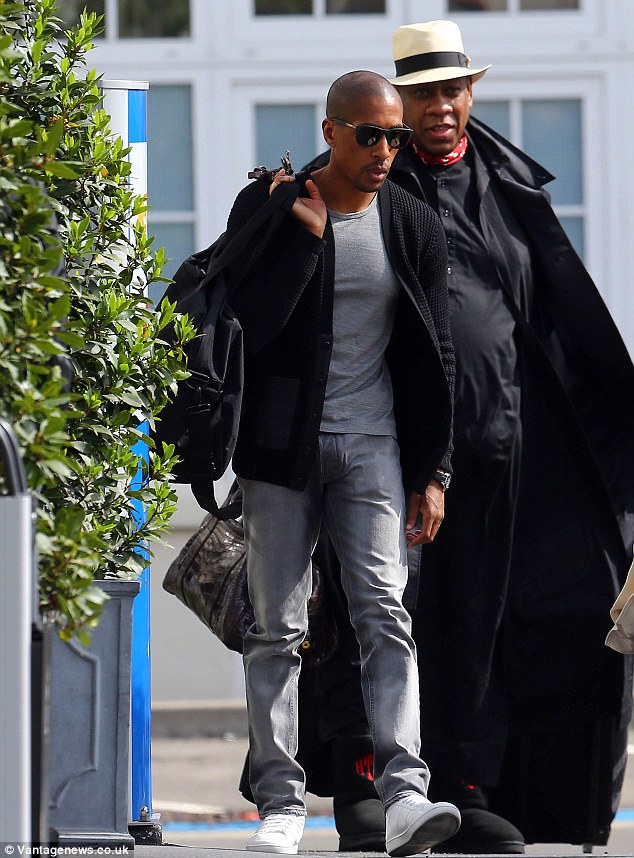 From Paris to Florence: KimYe's guests, pictured is Vogue's  André Leon Talley check in to fly across Europe - but there's no sign of Beyonce and Jay Z