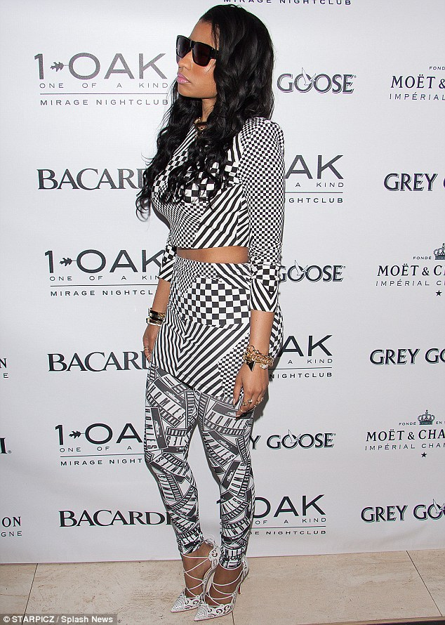 Fancy footwear: Nicki gave herself a boost with a pair of exquisite and dainty pointed toe white pumps, featuring many intersecting straps