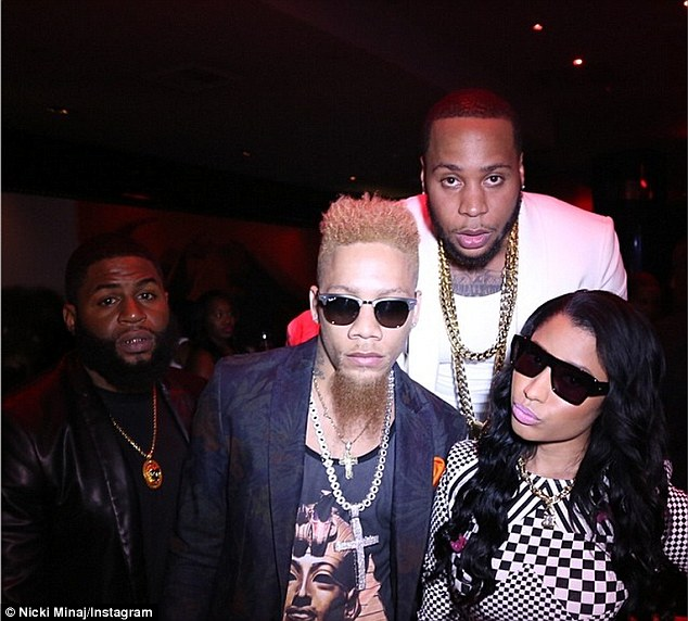 Partying it up: Nicki Instagrammed this image with friends in the nightclub