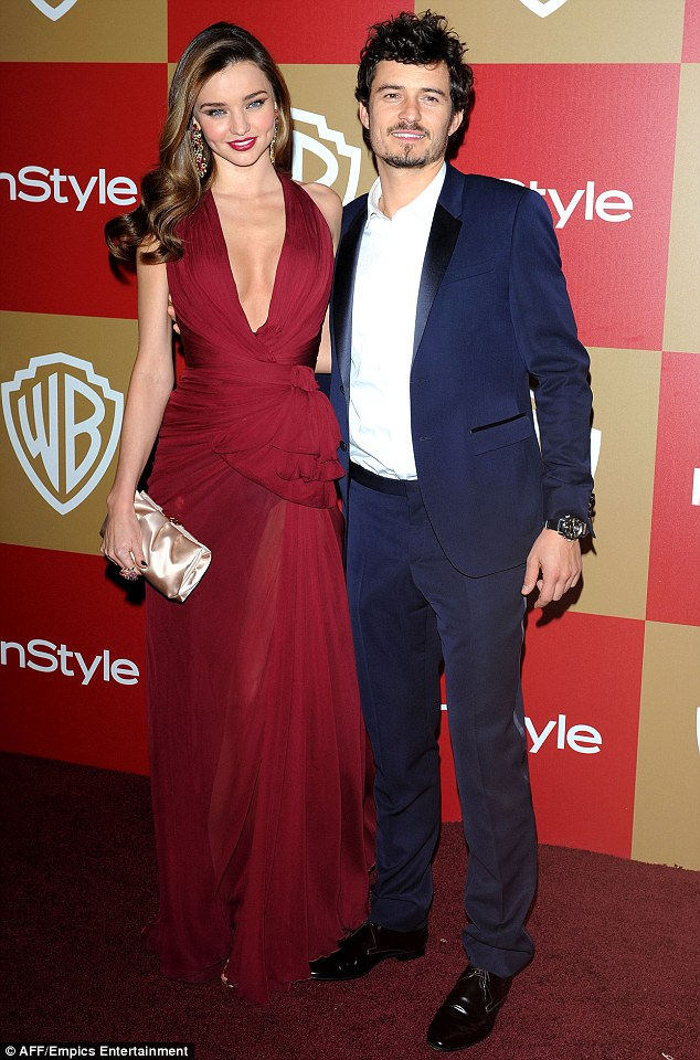 Friends! Miranda told MailOnline that she and Orlando still speak every day. They're seen here during happier days at a 2013 Golden Globe after party