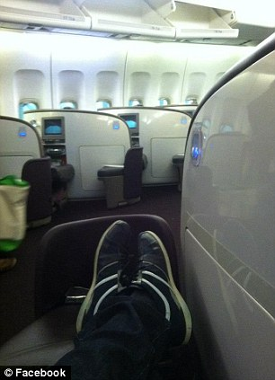 This image shows him flying first class