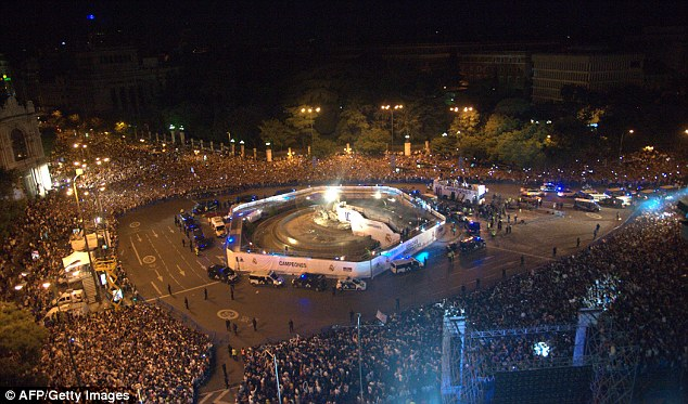 Turning out in force: The fans flock to Cibeles Square to celebrate with the Madrid players