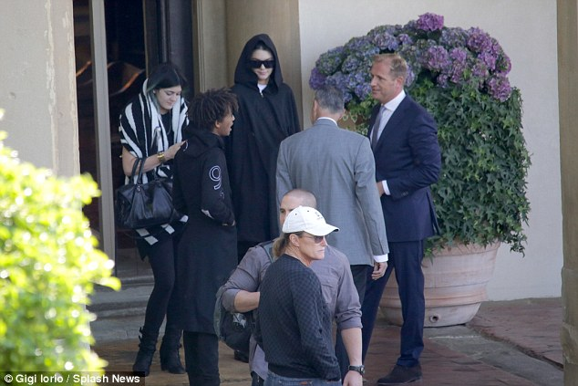 Early to rise: The family, including Bruce Jenner, caught up outside their hotel