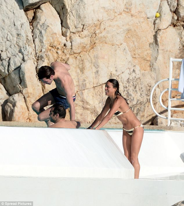 Bikini babe: Michelle joins some friends for a splash-around in a swimming pool