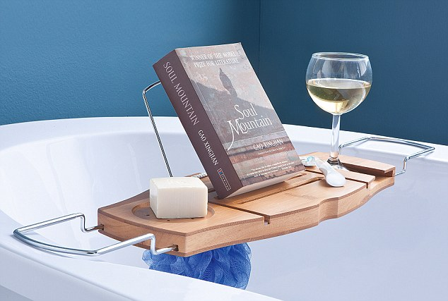 Gentler fare: Women prefer to read interiors glossies and romantic novels while relaxing in the bath