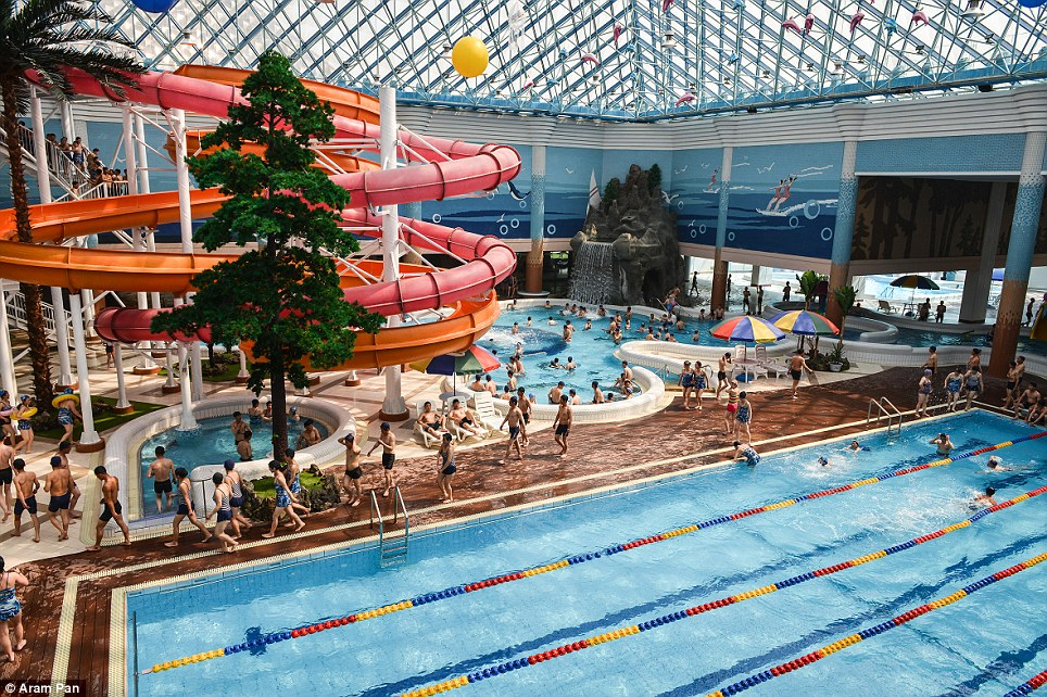 The Munsu Water Park in Pyongyang, North Korea, features colourful water slides, swimming pools and glass pyramids roofs. The complex opened in 2013 and appears popular with locals
