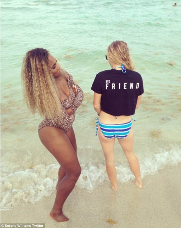 Beach babes: Serena had let her highlighted hair down, framing her face with her thick voluminous mane