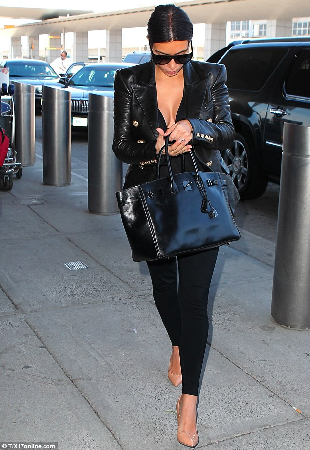 Alone already? Kim Kardashian was solo as she arrived in New York City following her European honeymoon