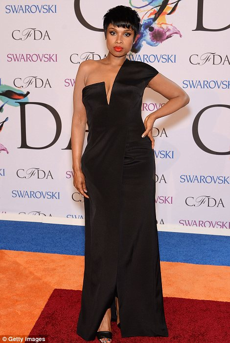 No need to watch her weight! The former Weight Watchers spokesperson Jennifer Hudson displayed her slim figure in a racy black evening gown from Kaufmanfranco  which displayed a hint of cleavage