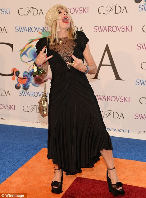 Aren't you supposed to be a designer? Betsey Johnson was a mess at the CFDA awards, ruining her pretty black dress with strange accessories and bizarre poses