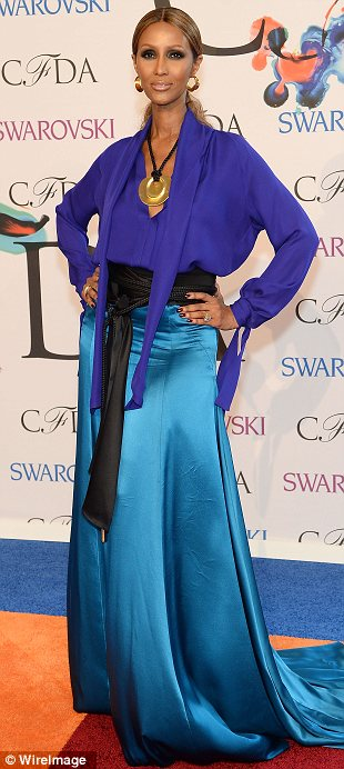 Colour pop: Beth Behrs, Iman and Hilary Rhoda stood out in their brightly coloured gowns on one of fashion's biggest nights