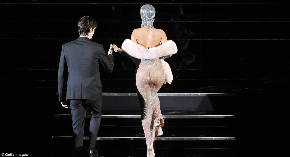 Quite an eyeful! As she made her way to the stage Rihanna flashed her pert bottom to the entire room