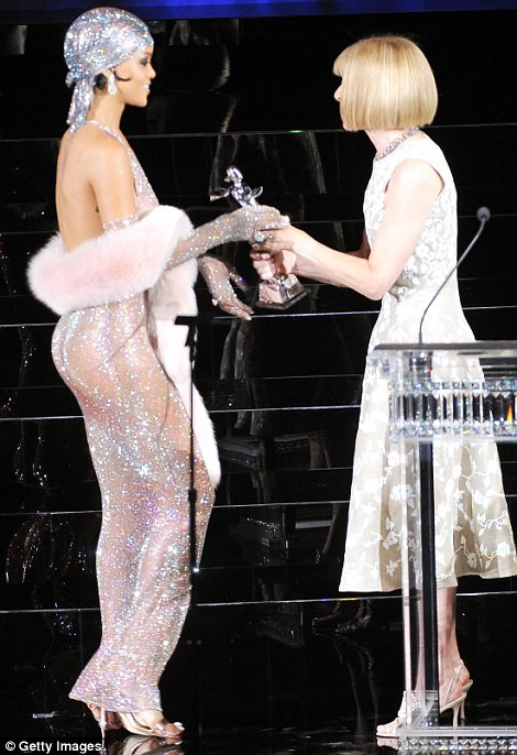 Does she approve? Anna Wintour presented Rihanna with her prize at the CFDAs but one wonder what she thinks of the star's attire