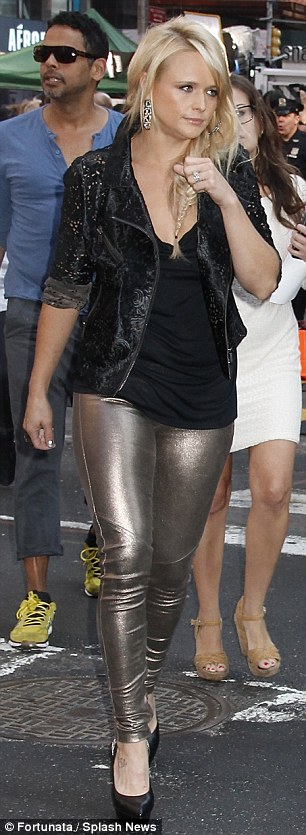 Rocker chick: She showed up in tight metallic gold trousers teamed with a black jacket and platform pumps