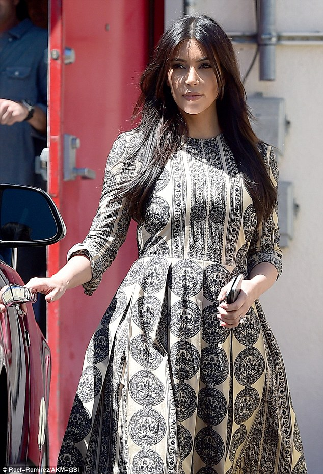 Ravishing: Kim sported glossy brown locks and sultry eye make-up for the outing