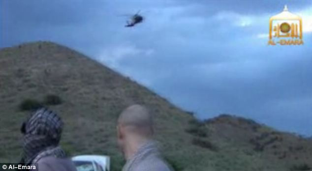 Bergdahl watches as one of the Black Hawk helicopters draws closer