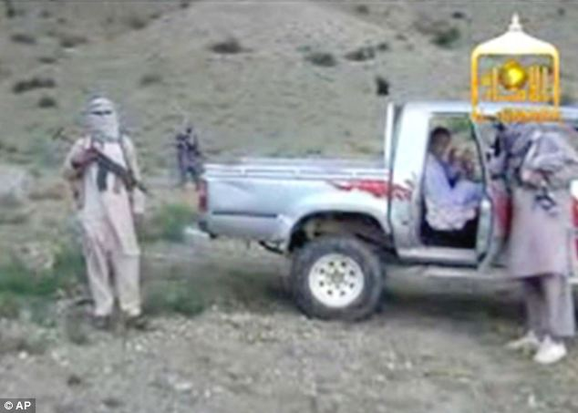 Guarded: Sgt. Bowe Bergdahl sits in a vehicle guarded by the Taliban in eastern Afghanistan