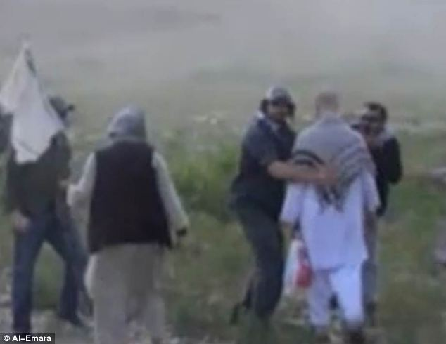 Patting down: Bergdahl can be seen being briefly frisked before he gets on the helicopter in the video