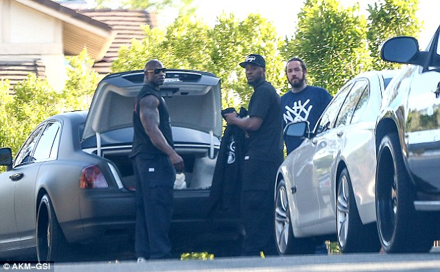 In hiding: Rapper Tyga was also said to have visited his friend, during which time the three buddies enjoyed a game of basketball, though he managed to get onto the property without being photographed as Brown's burly security detail made their presence known