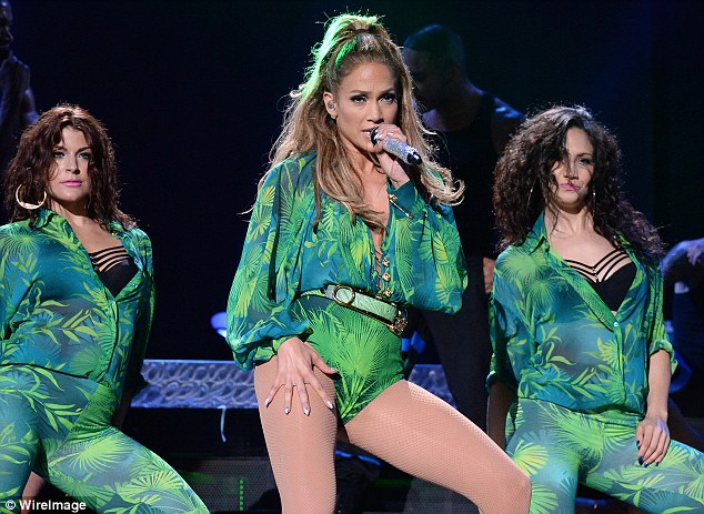Reliving the past: J-Lo paid homage to her legendary 2000 Grammy dress by Versace in this costume at her hometown concert in the Bronx on Wednesday
