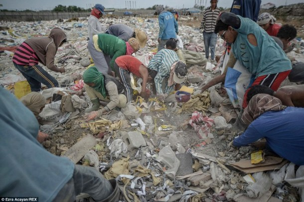 With thin gloves for protection, the so-called scavengers scrabble among the piles of rubbish to try and retrieve something for their day's work