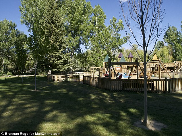 Children's playground: The trees planted to commemorate the capture of Sgt. Bowe Bergdahl stand in front of a play zone for children in Hailey, Idaho