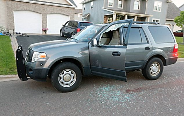 Broken glass and blood stains: the intended targets of these shootings was unclear as the cars appear to belong to civilians rather than police