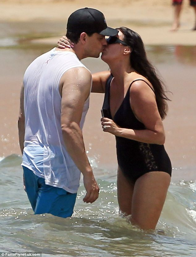 Romance: The engaged couple share a passionate kiss on the sands